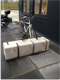Integrating seating and bicycle storage allows the sidewalk to have multiple functions in a minimal amount of space.
