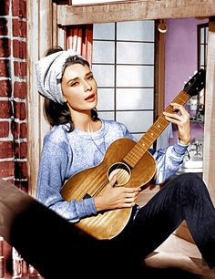 Audrey Hepburn, Breakfast at Tiffany's | Audrey Hepburn, ''Moon River'' Why it struck a chord: Hepburn strummed and sang a simple rendition for the 1961 film, but crooner Andy Williams made