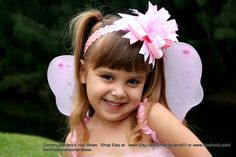 Any color available.  Pretty in Bling Hair Bow by Sammy by iguania03, $11.99