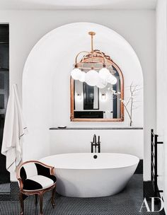 Black, white and rose gold makes for a beautiful bathroom
