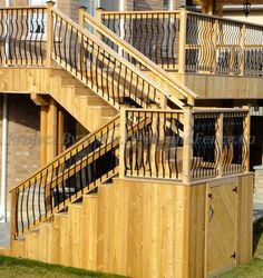 wrought iron railing of the 2-level deck #Toronto #Deckdesign #customdeck