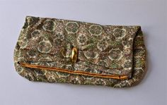 Hey, I found this really awesome Etsy listing at https://www.etsy.com/listing/151899762/vintage-fabric-bag-clutch-or-wallet