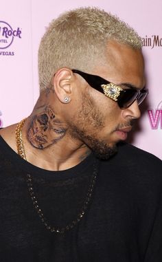 8. Chris Brown's Neck With a Face On It from Top 10 Celebrity Tattoos of 2012 | E! Online