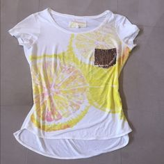 Studded pocket grapefruit tee Beat the winter blues and dream of summer in this anything but basic t shirt. Soft and lightweight, citrus print, distressed bronze studs on pocket. All studs in place. Karen Millen is a British designer so tag says size 4 but fits like a 2/xs Karen Millen Tops Tees - Short Sleeve