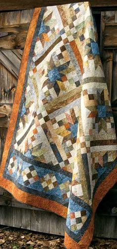 "SMOKEY RIVER PATTERN - Marbled prints add sparkle and interest. Traditional roots and modern appeal combine in this 75"" x 97"" pieced quilt. Pattern has Chris Hoover's directions. Price: $ 8.00 Part Number: 6375"