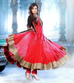 Buy Bollywood Actress Dia Mirza beautiful net salwar kameez suit in tomato red color which has golden pattern borders and sequined lining on the lehenga.