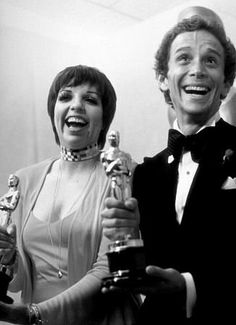 Liza Minnelli and Joel Grey with their Oscars in 1973 - Caberet