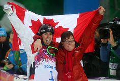 Alex Bilodeau celebrated Monday after winning gold in the men's freestyle skiing moguls at the Sochi Olympics with his brother Frederic, who...