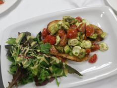 Bruschetta with tomatoes, avocado and mozzarella.