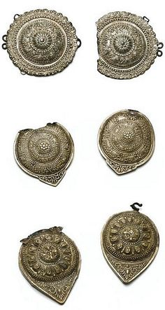 Women's belt buckles, originating from Jewish families in Greece.  Late-Ottoman style, ca. 1900.  Made of silvery metal (the first two) and of brass (the third one).  (© The Jewish Museum of Greece, Athens).