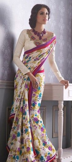 White Floral Saree in Georgette fabric and pink and purple border, perfect for that Valentine Day brunch