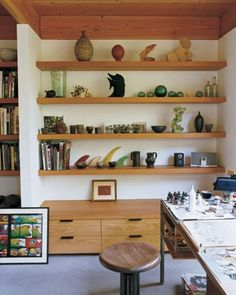 Floating wooden shelves against north wall for a mixture of books and treasures. Also like the storage/bench on bottom