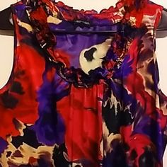 Silky ruffle collar sleeveless top Gorgeous jewel tones, great for work or play. Sleveless. Polyester I think, but feels smooth & has a nice shine to it.  Only worn a couple of times. Too small for me now. Notations Tops Blouses