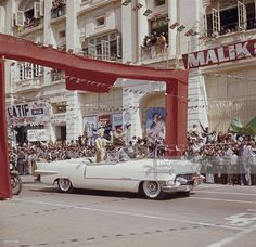 Queen Elizabeth II drives through Karachi in a white Cadillac, at the start of her visit to Pakistan, 1st February 1961. She is accompanied by Pakistani President Ayub Khan.