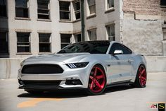 Silver Ford Mustang with Red Savini Rims