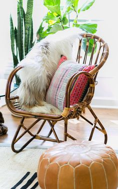 Decorist DesignOff with Jojotastic. Interior styling details — Franco Albini rattan chair draped with a sheepskin hide and Amber Interiors pillow.