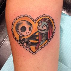 Providing an endless amount of inspiration, Tim Burton's Nightmare Before Christmas introduced us to Sally and Jack. And these two make a perfect tattoo all bundled in a heart created by tattooist Derek Oliver.
