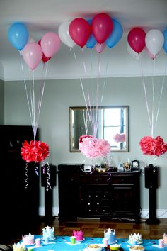 Party Decorations. Using Helium balloons to suspend decorations that can't be attached to ceilings.