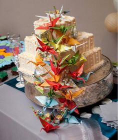 Small wedding cake with origami birds flowing down.JPG