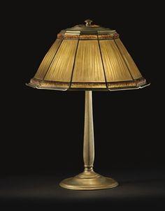 TIFFANY STUDIOS A u0027FAVRILE FABRIQUEu0027 LEADED GLASS AND GILT-BRONZE TABLE LAMP ,
