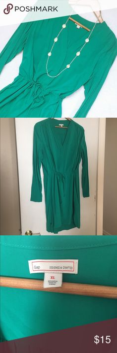 shirt dress Gorgeous green Old Navy shirt dress. Slightly hi-lo style, drawstring waist, long sleeves, v-neck with button front. Very, VERY feint mark near left breast, pictured in last photo. So barely noticeable that I wasn't sure if it was a mark or a wrinkle. I'm almost certain it will come out with a dab of stain remover and a wash. Otherwise excellent condition! Size XL. Old Navy Dresses Long Sleeve