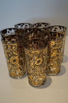 Vintage Hollywood Regency gold metallic and black floral drinking glasses. So rare to find a set of eight in mint condition!