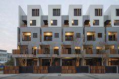"""Shen Ting Tseng Architects rethink the traditional Taiwanese terrace houses with a residential building made of """"breathing pockets"""" between houses at each level, and with roof gardens."""