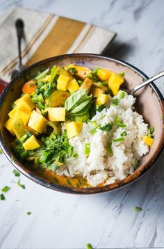 Summertime Mango Chicken Curry with Pressure Cooker Coconut Rice. A healthy and satisfying curry with summer fruits and vegetables on a bed of rich coconut rice.