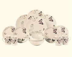 12 Piece Dinner Set With 4 FREE Mugs £30  12 piece lilac butterfly set with 4 FREE matching mugs. White porcelain coupe shape dinner set featuring a delicate butterfly and script design. The set comprises 4 of each- 27cm dinner plates, 20.5cm side plates, soup bowls and mugs. Microwave and dishwasher safe.  Postage £3.95 ( over £50.00 free)  Message me to order, and join my Group for other great offers.. http://www.facebook.com/groups/TravelsAndTailsOnlineStore