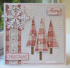 Pink and white grosgrain ribbon is lovely on this handmade Christmas card. Used as a border and as the trees, it makes a great non-traditional card color. I love the use of white embossed dots for the background and the rustic snowflake.