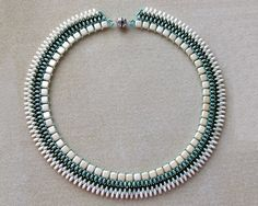Beaded necklace with Czech Tile and Superduo beads in shades of Pearl coat cream and green. The color combination gives the necklace elegance. The closure is by a super strong magnetic clasp in silver tone.  Measurements: The length of the beaded necklace is approximately 49 cm / 19.3 including the clasp.  The necklace is a handmade, very unique and special, and it was made with a lot of patience and love.  The designer is Yasmin Zarfati.  To see my other items please enter my shop…