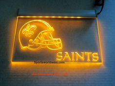 "New Orleans Saints Electric Light - $29.00 • Click on image for awesome view. • Solid state technology Simply plug it in and behold a beautiful lighted glowing sign for displaying in your window, Man Cave, Dorm, Bar, Home, Restaurant etc. • Logo and all four sides light as you can see in image – Awesome! • Solid state no batteries or bulbs needed. • Size: W 12""x H 9"" Available at: Sportsworldwest.com"
