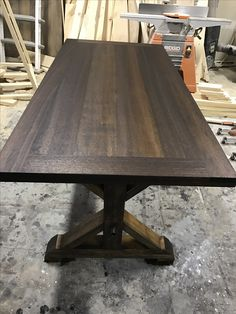 Mahogany farmhouse table by Frazer Construction Basement Furniture, Basement Stairs, Refinish Stairs, Acoustic Ceiling Tiles, Types Of Ceilings, Old License Plates, New Staircase, Ceiling Treatments, Man Room