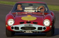 The Earl of March with Sir Stirling Moss in a Ferrari 250GTO