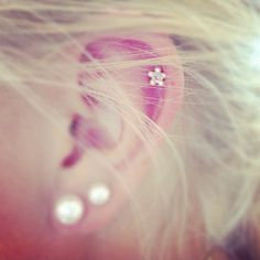 cartilage piercing... Really like it.... May happen sometime down the road. Especially if it's as cute as this picture!