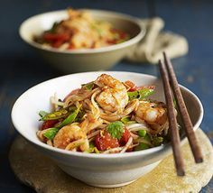 This seafood stir-fry, with fiery ginger and crunchy veg, is as healthy as it is delicious - a low-fat and low-calorie weeknight dinner