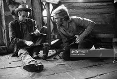 American actors Paul Newman (1925 - 2008) (left) and Robert Redford sit on the floor and check their guns in a scene from the film 'Butch Cassidy and the Sundance Kid' (directed by George Roy Hill), Durango, Mexico, 1968.