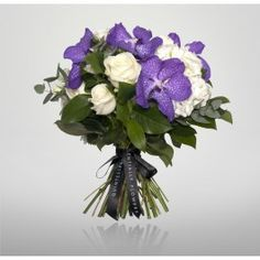 Blue Magic is a spectacular bouquet of blue vanda orchids and white roses