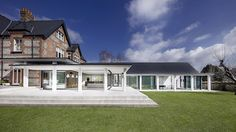The Pilot's House by AR Design Studio is a c. brick Winchester Villa that has been restored and contemporized with a glass extension housing modern open-plan living and an indoor poo… Design Studio, Winchester England, Winchester College, Glass Extension, Villa, Indoor Swimming Pools, House Extensions, Restaurant, Open Plan Living