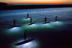 """from Hansen Surfboards  -   """"LED PADDLEBOARDING BY NIGHT""""  -    Photographer Julia Cumes shot this photo series, """"Paddling Dreams,"""" of stand up paddleboards equipped with waterproof LED lights that illuminated the water below the board. """"What I love so much about stand up paddle boarding is its ability to transport one, surrounded by nature, to a quiet, meditative state,"""" explains Cumes. """"So what could be more magical than having that experience on a moonlit evening?"""""""