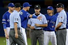 Aaron Sanchez, Troy Tulowitzki, Ryan GOins, TOR, and the umpires discussing the seventh inning//Game 5 ALDS v TEX, Oct 14, 2015