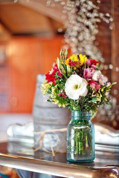 wild flowers in mason jars