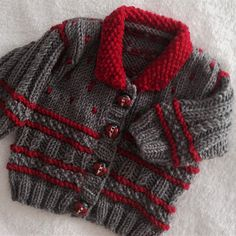 Winter warm is how this little jacket turned out. With some fun bobble spots to cheer up any cold day. Your little one will look cute as well as be warm. You could knit this in lighter colours for the early Autumn or spring. Worked flat on two needles, and in one piece to the armholes saving on seams. with a little lower neckline so it is not too tight for the little ones.