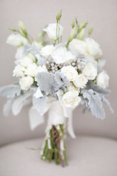 White and gray bouquet by Stems & Styles, image by Sleepy Fox Photography. #wedding www.weddingsunveiledmagazine.com