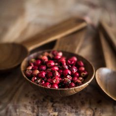 Wooden tablespoon of red peppercorns