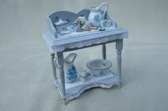 Dollhouse blue washstand made by Jolanda Knoop