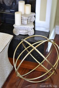 This DIY Gold Decorative Sphere is made entirely from hula hoops!