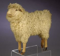 Late 19th Century German Sheep Figure with paper, wood and sheepskin.