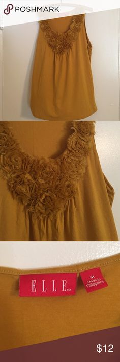 Mustard yellow tank top Yellow Elle tank top with really cute neck line! Can be dressed up or down. Looks great with jeans! Medium. Elle Tops Tank Tops