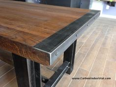 Detail of steel edging and steel work on trestle table. Made by Carbon Industrial Design.